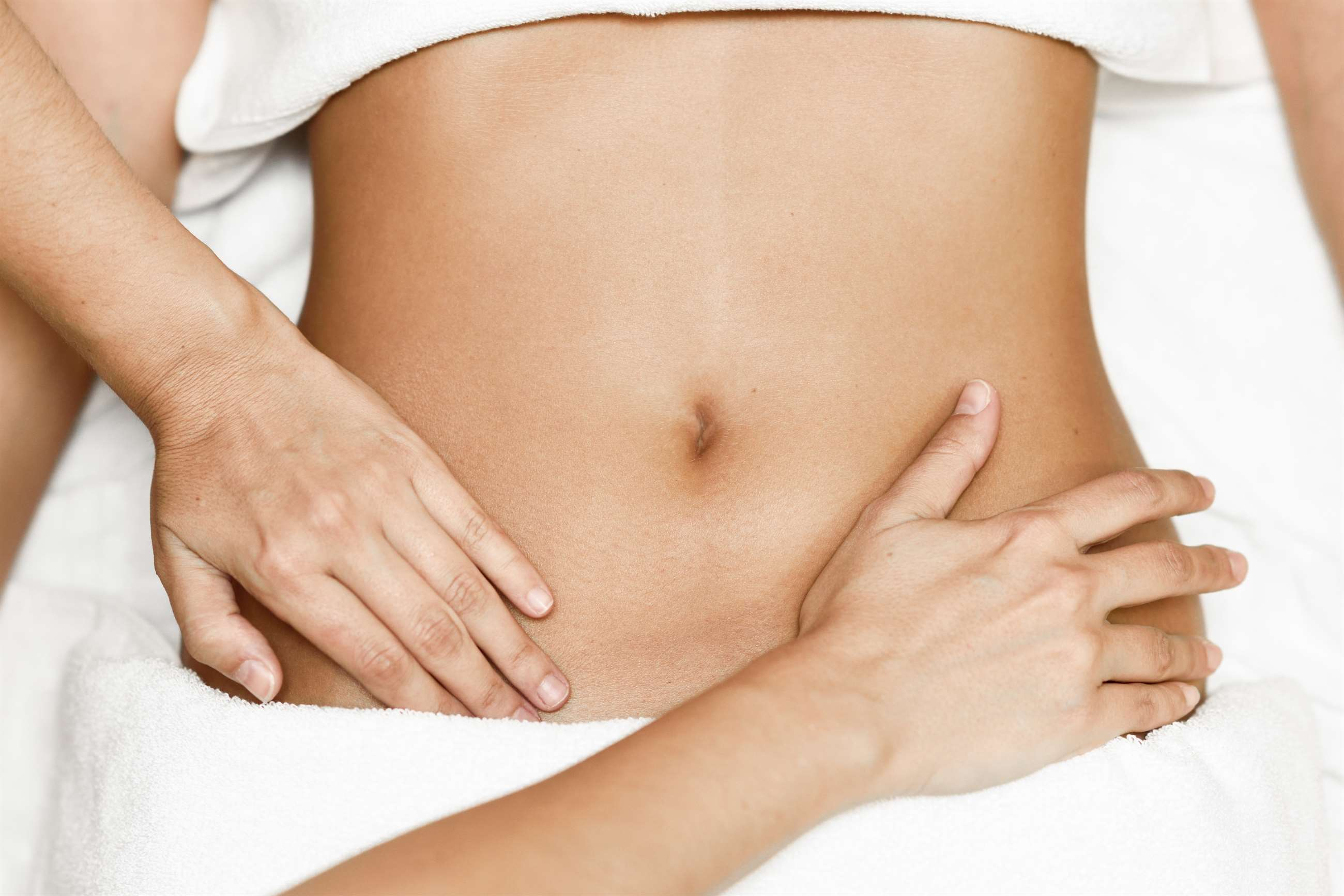 bigstock-hands-massaging-female-abdomen-244348390